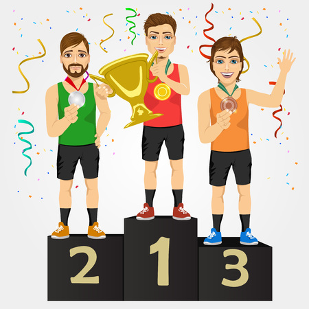 achievment: young sports men holding a cup and medals celebrating on the winners podium isolated on white background