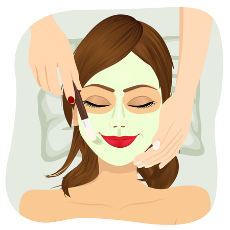face treatment: Beautiful woman with cosmetic mask on face. Girl getting treatment in spa salon
