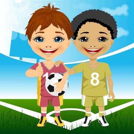 multiracial: Two cute multiracial youth soccer players wearing their team uniforms showing thumbs up ang holding a ball