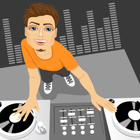 disc jockey: Top view portrait of of male disc jockey mixing the track using his turntables