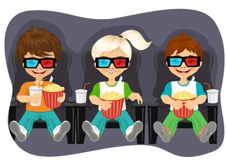 movie theater: Smiling kids with popcorn watching 3D movie in cinema theater