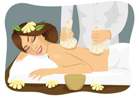 lying in bed: Thai herbal poultice massage - young woma lying on a spa bed
