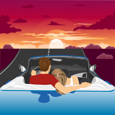 convertible car: Couple in hug watching the sunset together in blue convertible car