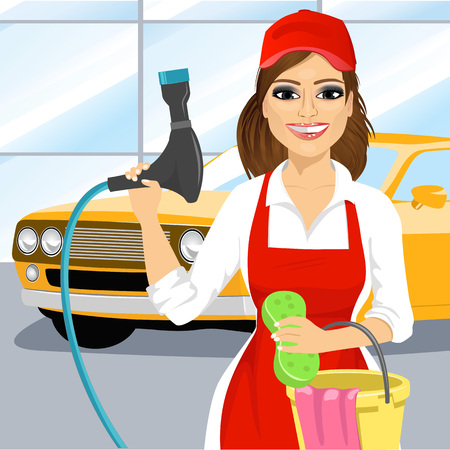 carwash: Smiling young girl with a soapy sponge and hose to wash a car in carwash