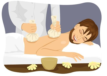 lying in bed: Thai herbal poultice massage - young man lying on a spa bed
