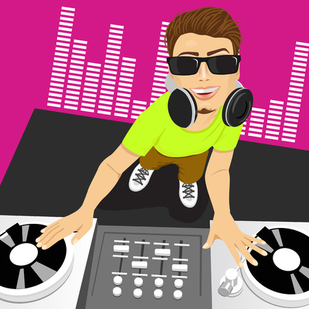 disc jockey: Top view portrait of of male disc jockey with sunglasses mixing music using his turntables