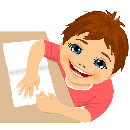 homework: cute little boy doing homework top view isolated on white background