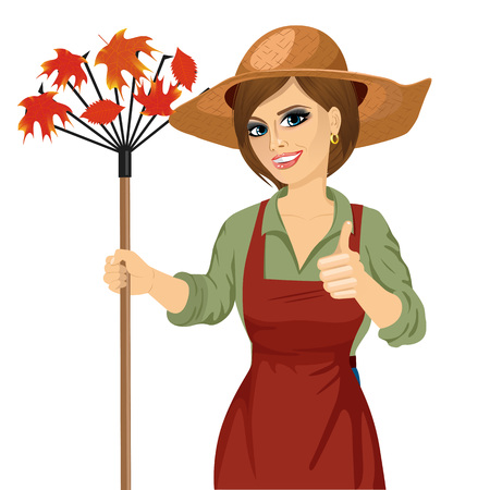 woman gardening: Gardening. Woman with garden hat holding rake and showing thumbs up isolated over white background