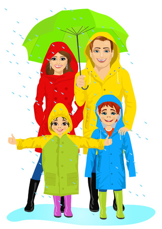 happy family in raincoats standing with umbrella in the rain