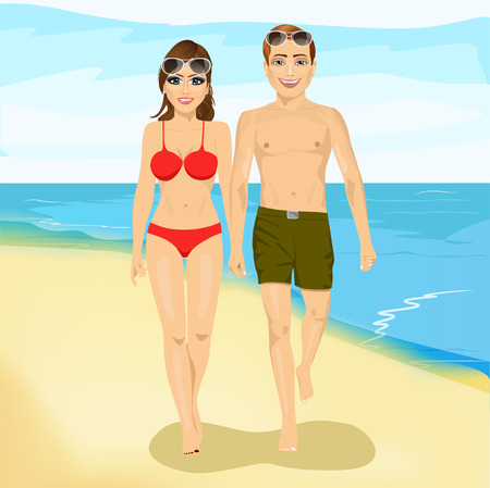 happy couple beach: full length portrait of happy couple walking along a beach