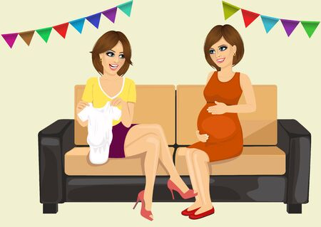 two beautiful women on a baby shower party, one of them brought baby clothing to pregnant woman