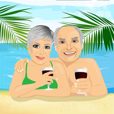 vacation time: lovely senior couple drinking red wine lying on the beach enjoying retirement vacation time