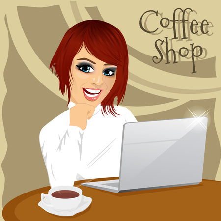 red haired girl: portrait of red haired young hipster woman with laptop enjoying a hot coffee in coffee shop