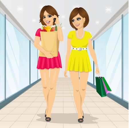 full length portrait: full length portrait of two young women holding grocery shopping paper bags walking in supernarket