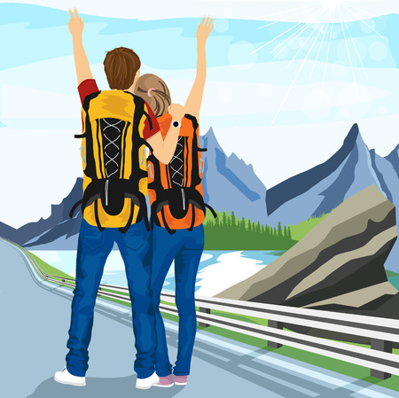 rear view: rear view of young couple of hitchhikers standing on road and enjoying mountain scenery