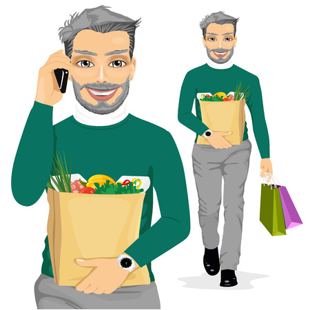 mature: mature man carrying grocery paper bag full of healthy food while talking on the mobile phone