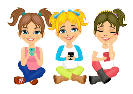 little girls: three cute little girls sitting on floor using their smartphones smiling happy isolated over white background