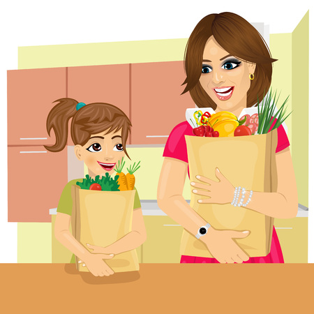 cute young daughter helps her mother to carry groceries paper bags in kitchen