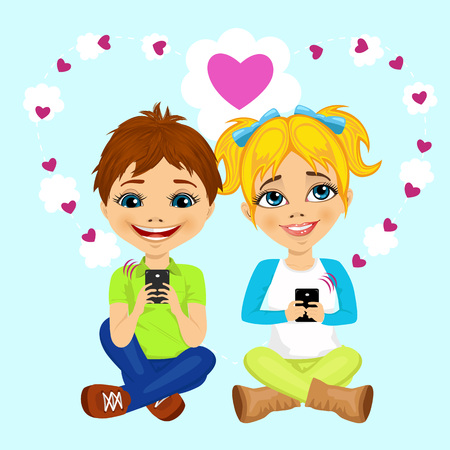 happy teenagers: young happy teenagers sending love messages using cellphone wireless communications
