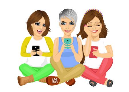 Tre giovani donne attraenti seduto sul pavimento con i loro smartphone sorridendo felice isolato su sfondo bianco Archivio Fotografico - 55023461