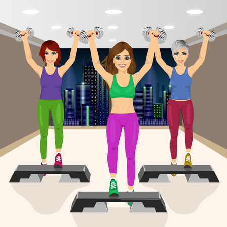aerobics class: three beautiful young girls doing aerobic exercises at gym smiling