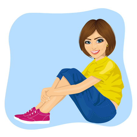 young woman sitting: young woman sitting on the floor isolated over blue background