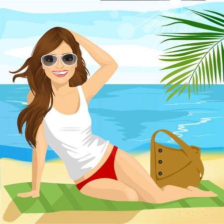 Portrait of beautiful brunette with sunglasses sunbathing on the beach sitting on a towel