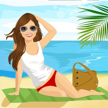 Ritratto di bella bruna con gli occhiali da sole prendere il sole sulla spiaggia seduto su un asciugamano