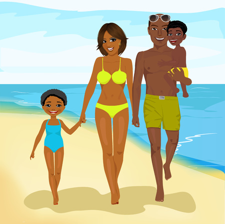 mixed race children: young african american family walking happy along beach