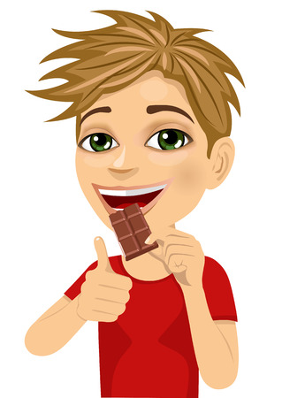 youthful: Cute boy eating chocolate showing thumbs up isolated on white background
