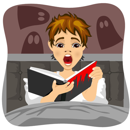 teen boy: Afraid little boy reading book indoors. Shadow of ghost is on the wall