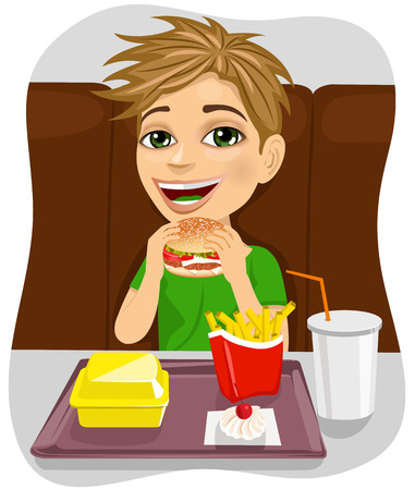 coke: young boy eating cheeseburger with french fries and coke in fast food restaurant