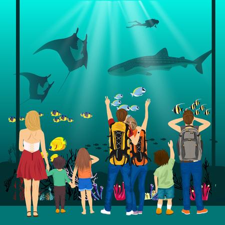 oceanarium: people watching underwater scenery with sea animals in a giant oceanarium