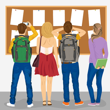 college students: back view of college students looking at a bulletin board