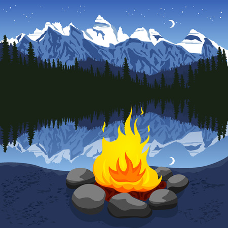 Campfire with stones near mountain lake reflecting the night sky