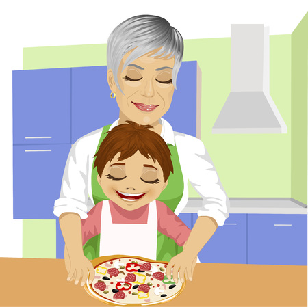 preparing: Happy family, grandmother with her grandson preparing delicious pizza together in kitchen
