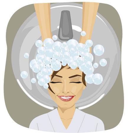 gelukkige jonge vrouw met kapper wassen hoofd op kapsalon