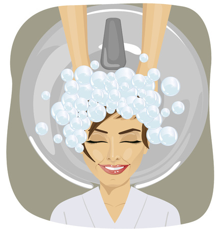 woman washing hair: happy young woman with hairdresser washing head at hair salon
