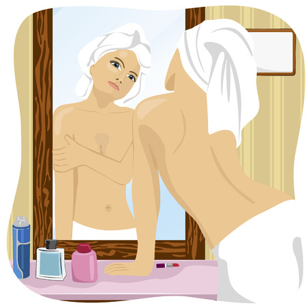 looking in mirror: Woman wrapped in white towel looking at herself in the mirror in the bathroom