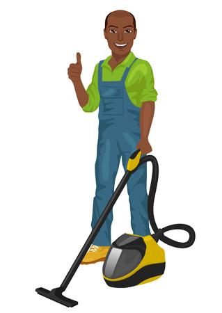 African American uomo in tuta verde in posa con un aspirapolvere e dando pollice in alto