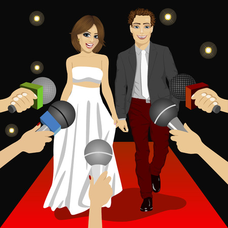 reporters: Young fashionable couple on a red carpet event before press reporters