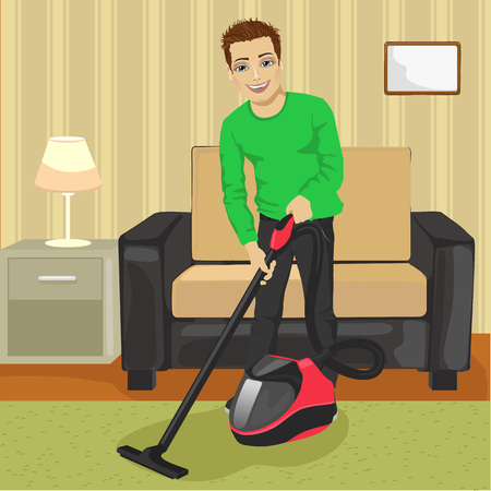 dirty carpet: Full length of young man cleaning carpet with vacuum cleaner at home