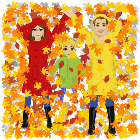 autumn woman: top view of young happy family of daughter mother and father lying on autumn leaves in the park