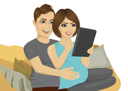 using tablet: young pregnant couple sitting on sofa using tablet computer over white background