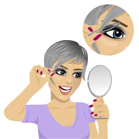 young woman plucking her eyebrows with tweezers looking at mirror over white background