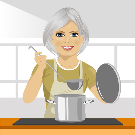 mature adult: Smiling mature woman with a ladle cooking soup in pan at domestic kitchen