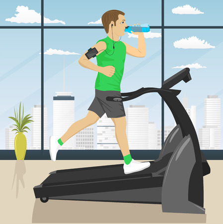 man drinking water: man at the gym doing exercise on the treadmill with smartphone armband drinking water