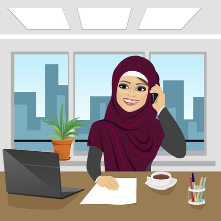 talking phone: business arab woman with laptop at office wearing hijab talking on the phone