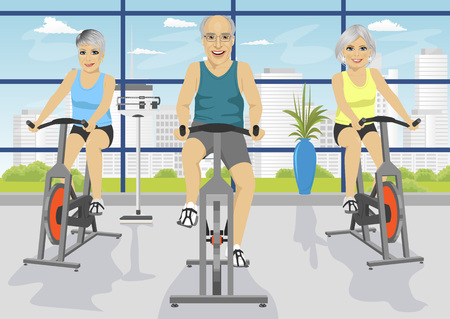senior exercise: Senior people working out at the fitness center on exercise bikes