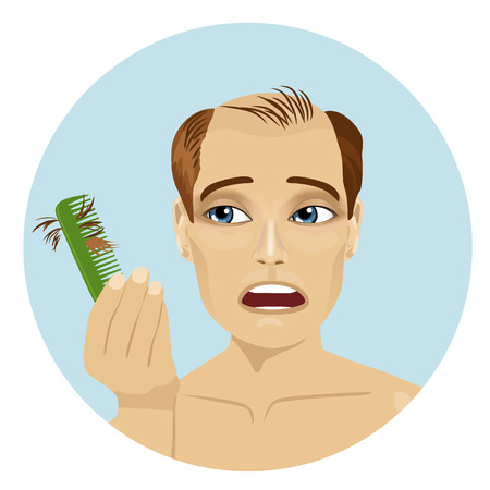 Young man worried about hair loss holding a comb looking at it